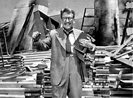 Burgess Meredith as Henry Bemis clutching books in 'Time Enough at Last'
